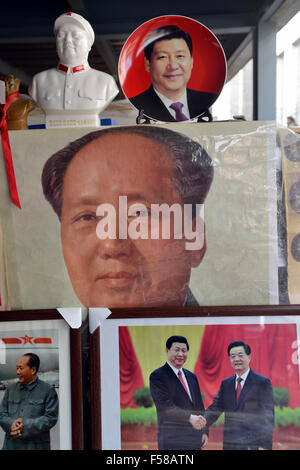 Memorabilia of Chinese president Xi Jinping is on sale with that of Mao Zedong and Hu Jingtao in a flea market in - Stock Photo