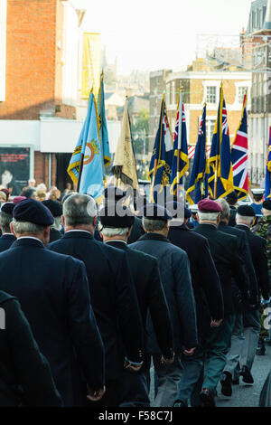 England, Ramsgate. November Remembrance Sunday. View from behind of parade marching through street with ex-servicemen - Stock Photo