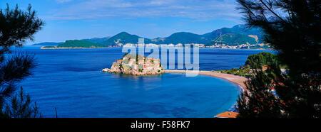 Montenegro, Adriatic coast, Bay of Budva, Island of Sveti Stefan (St. Stephen), once a fishing village, now a luxury - Stock Photo