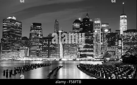 Black and white photo of Manhattan waterfront at night, New York City, USA. - Stock Photo