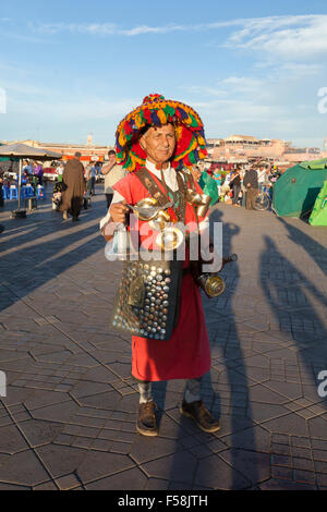 Portrait of a water carrier at Jemaa el Fna,  Marrakech, Morocco - Stock Photo