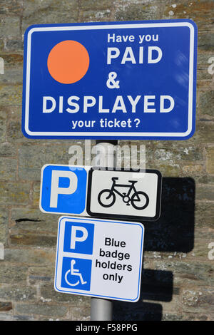 Have You Paid & Displayed parking sign, Blue Badge Holders Only, and Bicycle parking sign - Stock Photo