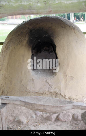 The old bread oven - wood-burning stove - Stock Photo