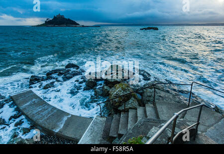 St Michael's Mount as seen from Marazion in Cornwall on a high tide in the early evening. - Stock Photo