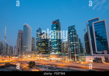 Skyline of new office towers at night  in Business Bay district of Dubai United Arab Emirates - Stock Photo