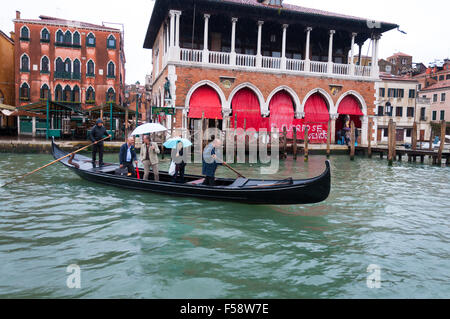 Crossing the Grand Canal by traghetto ferry in the rain, Venice, Italy - Stock Photo