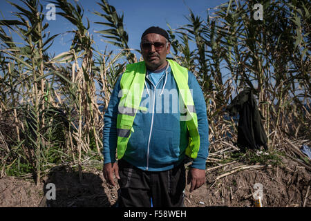 Lesvos, Greece. 30th Oct, 2015. Volunteer Khalid Mehmood, 48, came from Bolton near Manchester in the UK to help - Stock Photo