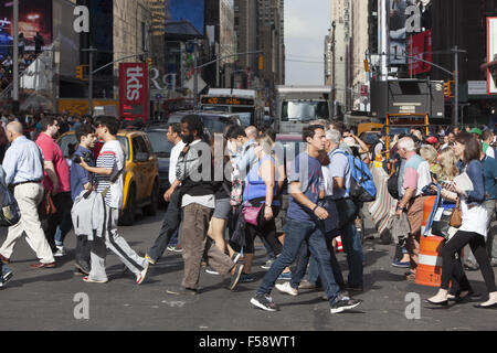 Just another day jammed with tourists on the street in Times Square, New York City. - Stock Photo