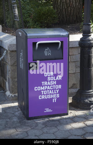 Trash can compactor run on solar power at the Union Square Farmers Market in Manhattan, NYC. - Stock Photo