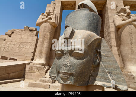 Head of  Ramesses 2 in the Ramesseum, Mortuary Temple of Ramesses II on West Bank of the Nile at Luxor, Egypt - Stock Photo