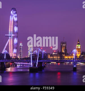 An evening view of London taking in the sights of the Houses of Parliament, the London Eye and the River Thames. - Stock Photo