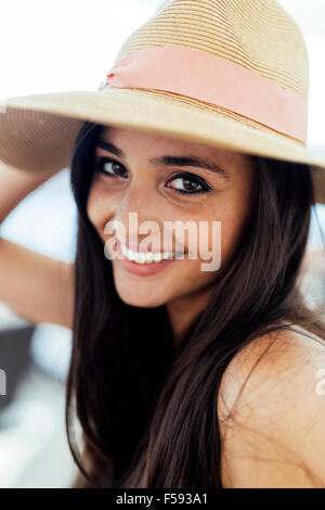 Woman in hat smiling and being truly happy - Stock Photo