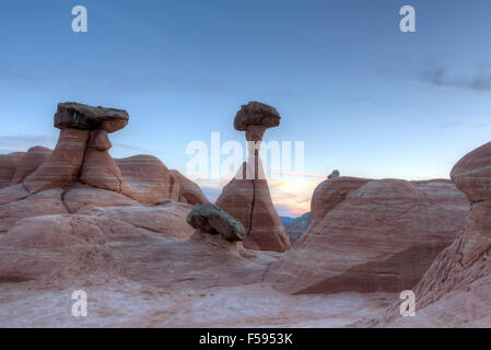 Desert dusk hoodoo rock formations at the Toadstools in Southern Utah. - Stock Photo