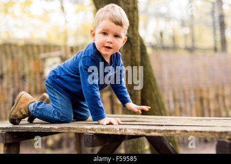 Handsome little boy in the park - Stock Photo