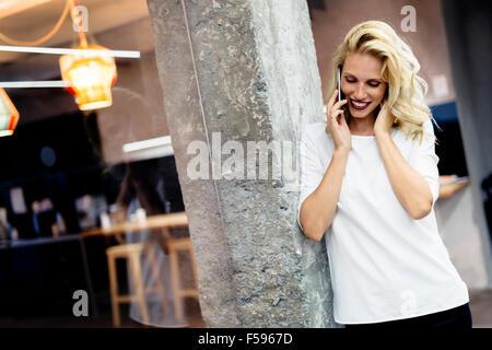 Beautiful woman talking on mobile phone - Stock Photo