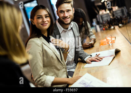 Business people in a pub relaxing and having fun - Stock Photo