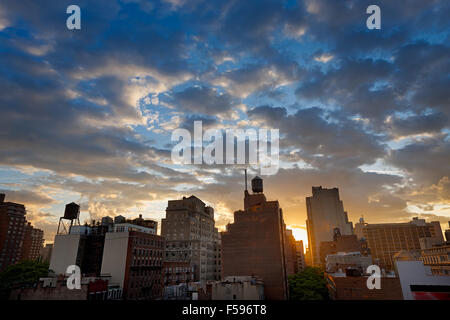 New York City, Chelsea neighborhood and its skyline dotted with water tanks at sunset. Along 8th Avenue, Manhattan, NYC