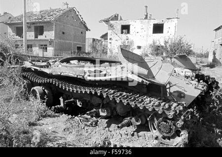 Kosovo, July 2000, Serbian tank destroyed by NATO attacks with depleted uranium grenades - Stock Photo