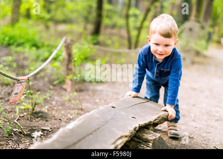 Little beautiful boy in the park - Stock Photo