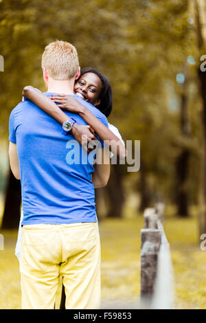 Couple in love hugging peacfully outdoors and being truly happy. Feeling of security and serenity - Stock Photo