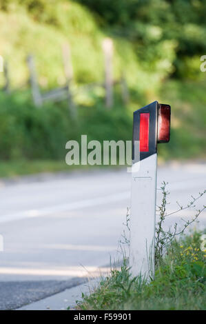 Side marking along empty country road - Stock Photo