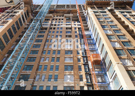 High-rise condominium building under construction - Washington, DC USA - Stock Photo
