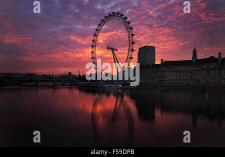 The Coca-Cola London Eye ferris wheel is seen at sunrise near the River Thames, in London, England, 2015. (Adrien - Stock Photo