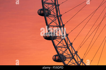 The London Eye ferris wheel is seen at sunrise near the River Thames, in London, England, on May 25, 2015. (Adrien - Stock Photo
