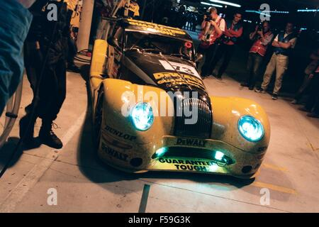 Morgan Aero 8 racing car in yellow dewalt tools livery as driven in the 24 hours le mans 2002 and 2004 - showing - Stock Photo