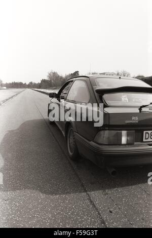 Ford Sierra RS Cosworth - in black on road test in 1986 when launched new  - showing rear and side of car mk1 1st - Stock Photo