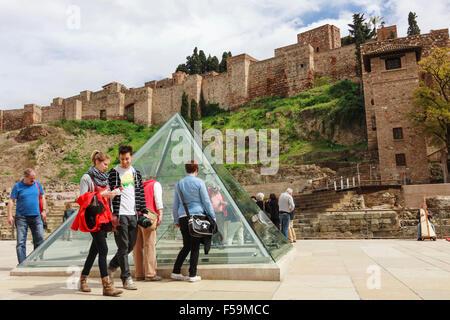 Malaga, Spain. People next to Alcazaba moorish castle. - Stock Photo
