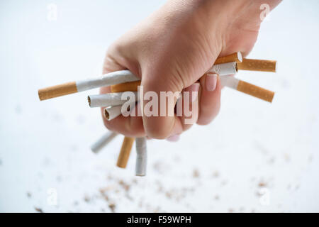 Bunch of cigarettes in hands - Stock Photo
