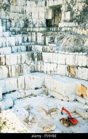 White marble quarry with excavators. Carrara, Tuscany, Italy Stock Photo