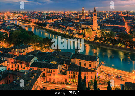 Santa Anastasia church and Torre dei Lamberti at dusk along the Adige river in Verona, Italy. Taken from piazzale - Stock Photo