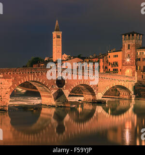 Ponte Pietra bridge at dusk over the Adige river in Verona, Italy - Stock Photo