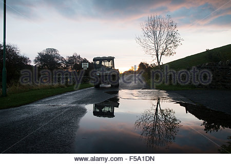 Holwick, Middleton-in-Teesdale, Co Durham, UK. 31st October 2015. Weather: A farmer working after the overnight - Stock Photo