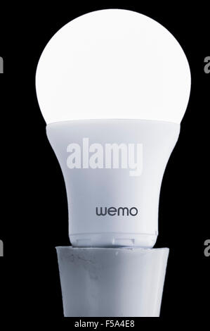Wemo LED bulb which provides home automation and is controlled by a Smartphone app over the internet and Wifi - Stock Photo