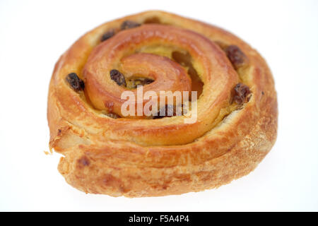 A Pain au raisin pastry - studio shot with a white background and shallow depth of field - Stock Photo
