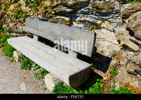Wooden bench made of tree trunks - Stock Photo