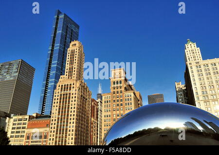 Cloud Gate (also known as The Bean and The Kidney Bean) sculpture below a section of the  Chicago skyline. Chicago, - Stock Photo