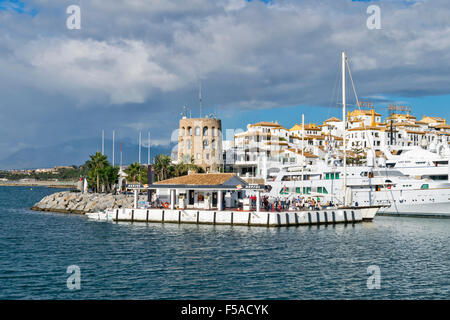 PUERTO BANUS ANDALUCIA SPAIN HARBOUR WITH TOWER AND FUEL PUMP AREA - Stock Photo
