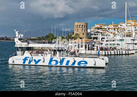 PUERTO BANUS ANDALUCIA SPAIN HARBOUR WITH FLY BLUE FERRY AND PASSENGERS - Stock Photo