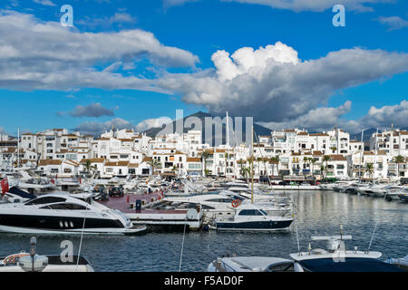 PUERTO BANUS ANDALUCIA SPAIN HARBOUR WITH MOUNTAIN AND CLOUDS - Stock Photo