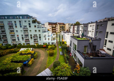 View of apartment buildings and a park in Berlin, Germany. - Stock Photo