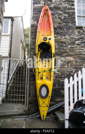 A canoe stored vertically against a wall in Port Isaac. - Stock Photo