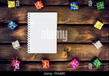 Boxes with gifts on a dark wooden boards - Stock Photo