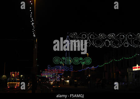 Night view, north to Tower, colourful Scrolls across Central Promenade by tramway with Frigate Tram, Blackpool Illuminations, - Stock Photo