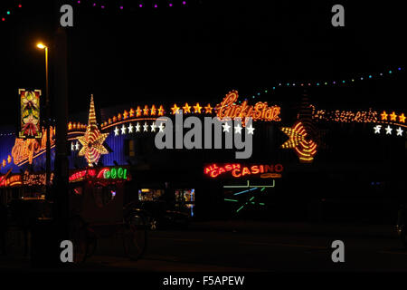 Night view, looking north, multi-coloured Lucky Star Amusement Arcade, Central Promenade, Blackpool Illuminations, - Stock Photo