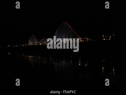 Night oblique beach view to the high point and drops of the Big One Rollercoaster, Pleasure Beach, Blackpool Illuminations, - Stock Photo