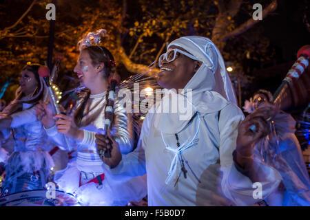 New York, NY - 31 October 2015. Drummers from the Batala NYC Samba Reggae Drum Band warm up in SoHo Square before - Stock Photo